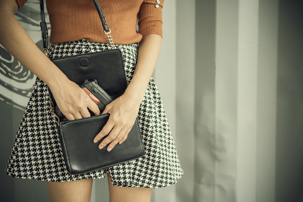 woman with gun in purse