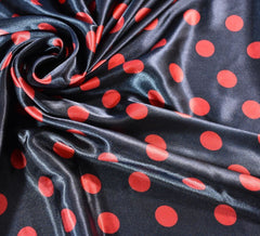 Red Spot on Black Silky Satin Fabric