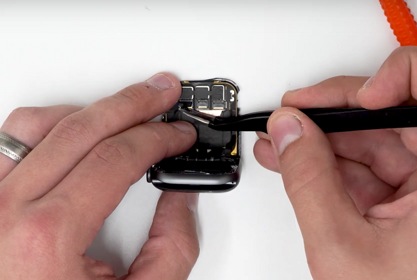 Peeling the adhesive off of the ribbon connectors
