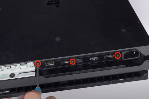 Remove the 3 screws on the back of the Playstation