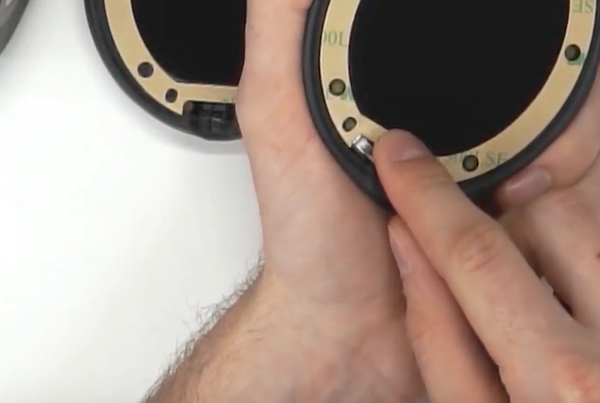 Using a screwdriver to peel the backing off of the tape