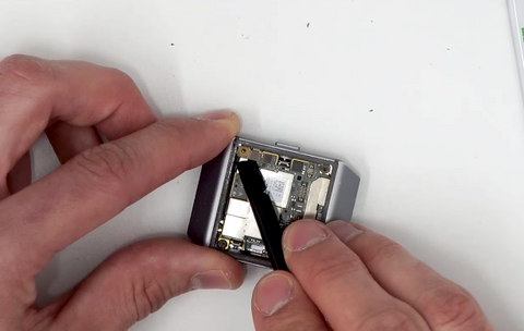 Removing the metal bracket that secures the battery ribbon plug