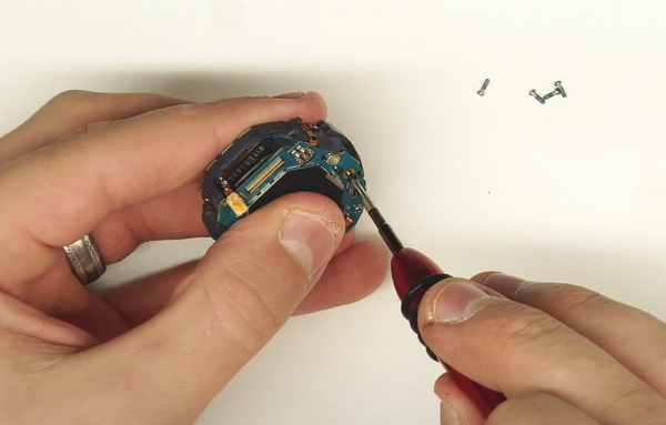Re-inserting the black Phillips head motherboard screw