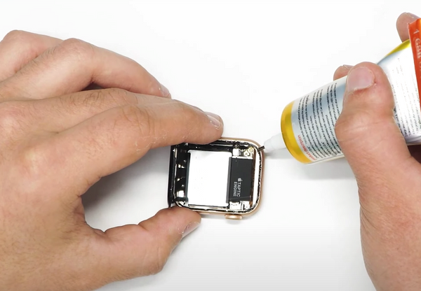 Applying a thin line of glue around the edge of the Watch