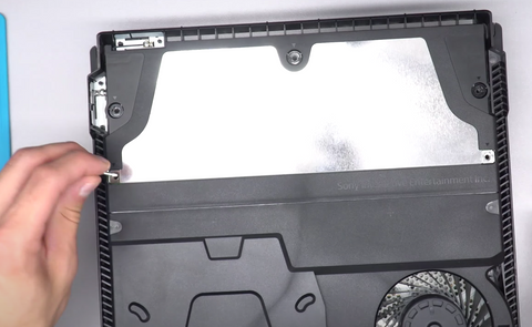 Placing the 5 screws back into the top of the power supply
