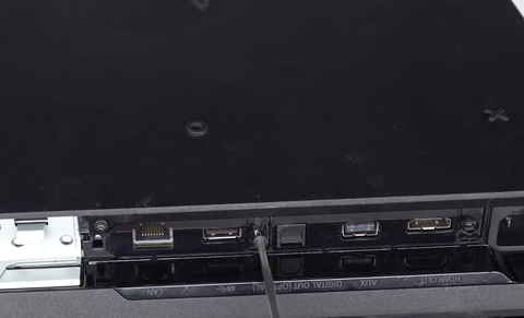 Reinstalling the 3 black screws at the back of the console