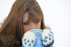 Photo Credit - Girl wearing mittens