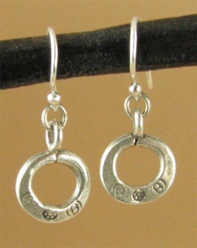 Small round hoop earrings.Fine silver. Flower stamped. Sterling silver hooks.