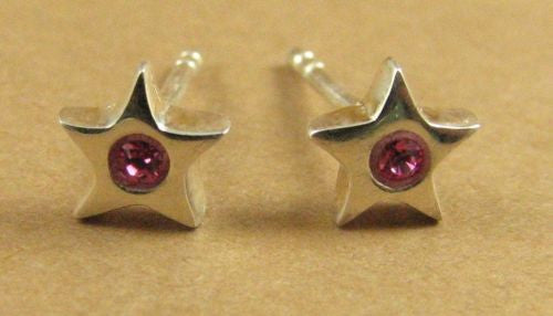 Tiny pink star stud earrings, made with Swarovski Elements. Sterling silver.