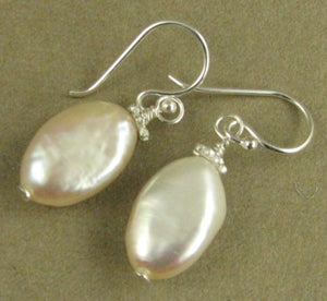 Off-white pink/peach pearl oval earrings. Sterling silver. Designer handmade.