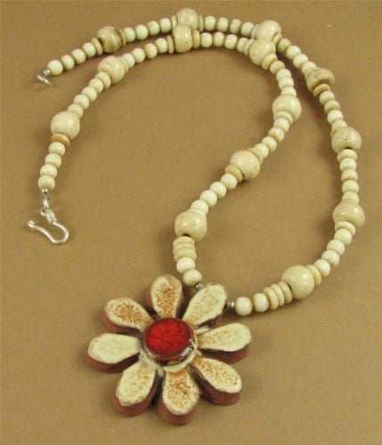 Ceramic flower necklace with buffalo bone beads. Fine and sterling silver.