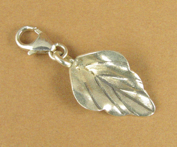 Leaf clip-on charm. Folded open. Lobster clasp. Sterling silver 925.