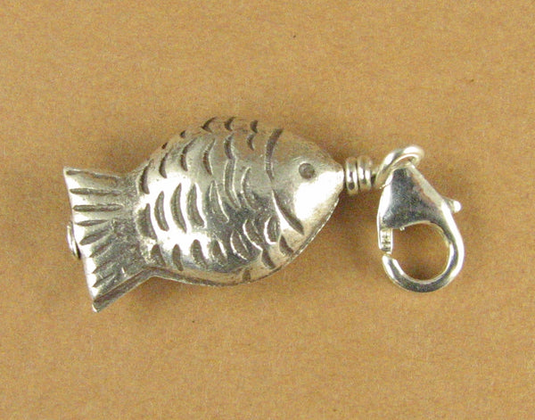 Fish clip-on charm. Round, patterned. 2 sided. Secure clasp.Sterling silver 925.