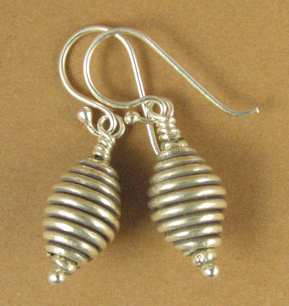Oval shaped spiral silver earrings. Fine & Sterling silver 925. Handmade.