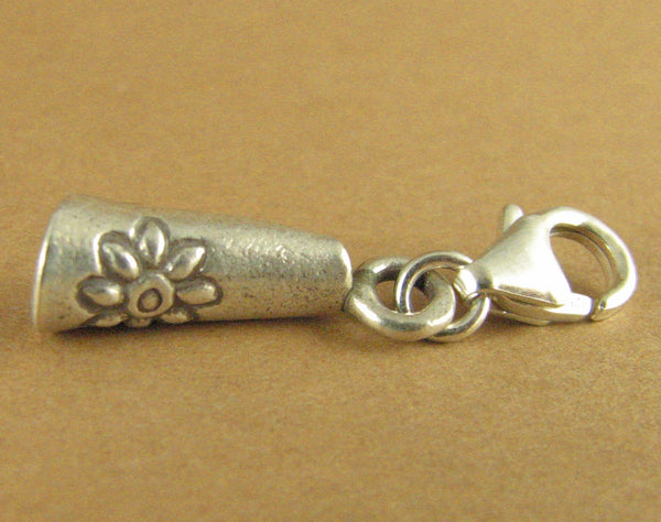 Rolled silver clip-on charm with flower stamp. Sterling silver 925. Handmade.