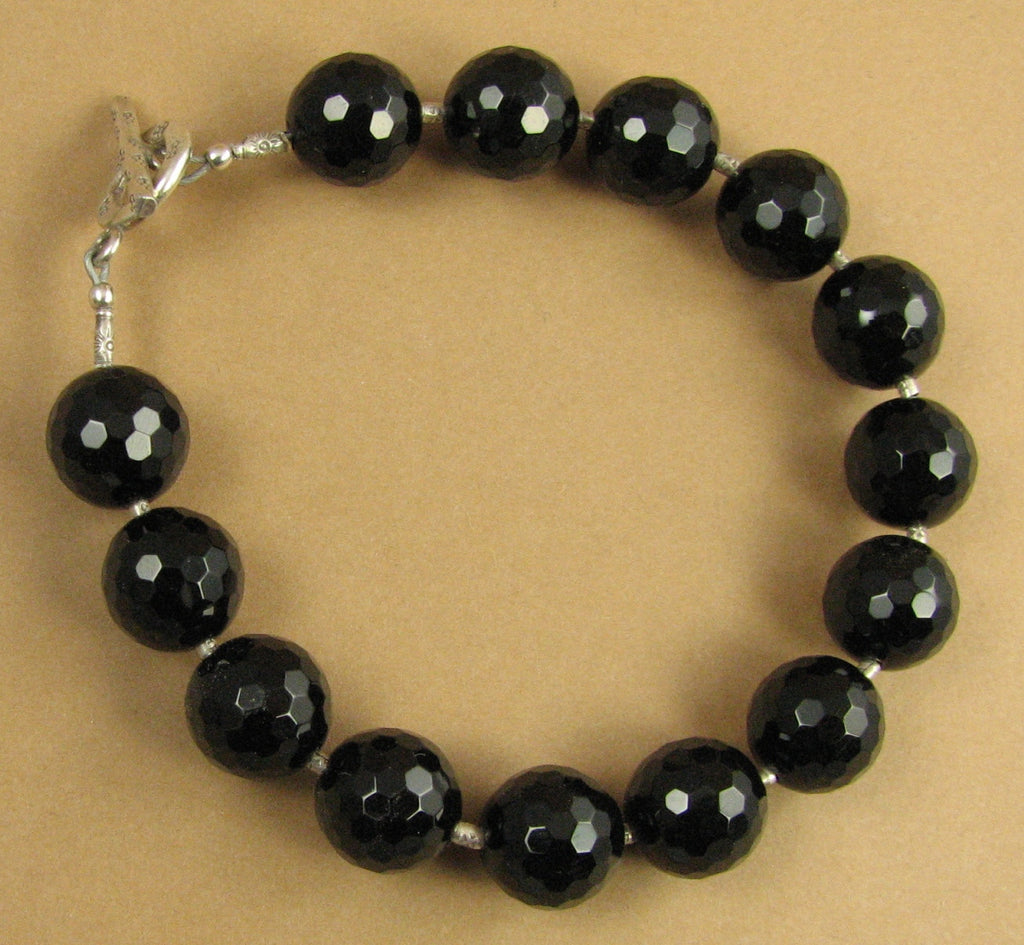Black onyx and silver bracelet. Chunky, faceted.