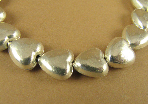Simple fine silver heart bracelet. Double sided hearts. Sterling silver.