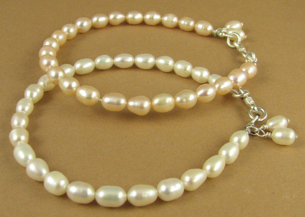 Pearl bracelet with dangle. White or peach. Sterling silver. Real pearls.