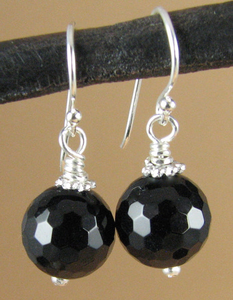 Black onyx earrings. Round, faceted. Sterling silver hooks