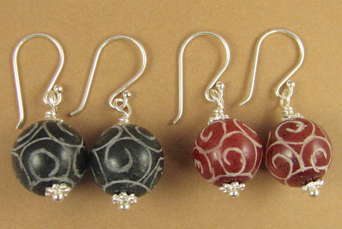 Carved stone earrings. Black or red. Sterling silver. Tibetan style