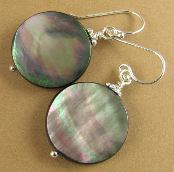 Black shell earrings. Big. Rainbow iridescent. Round. Sterling silver.