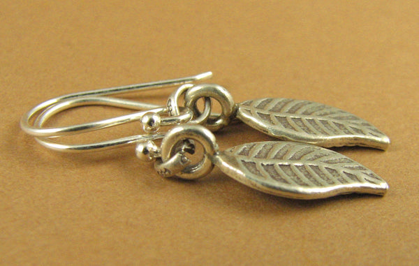 Curvy leaf shaped silver earrings. Small. Fine silver & sterling silver hooks 925.