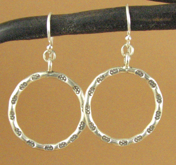 Large thin hanging hoop earrings. Round, flower stamped. Sterling silver 925