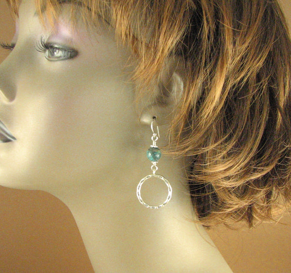 Large hanging hoop earrings with turquoise stone. Sterling silver 925.