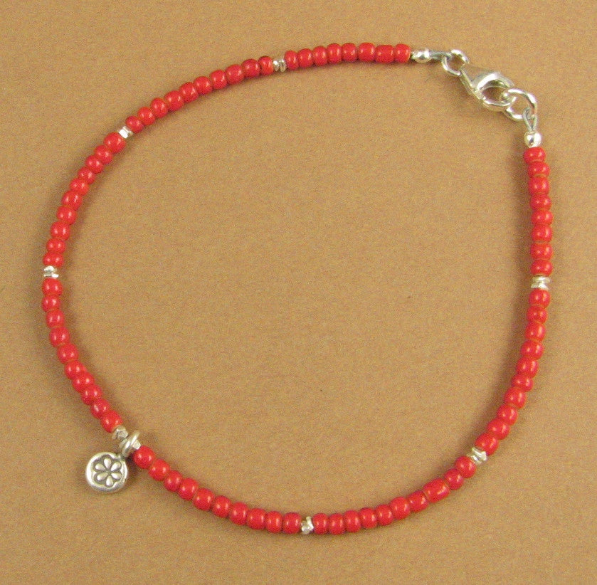 Dainty bright red African glass bead bracelet. Dangle. Fine & sterling silver.