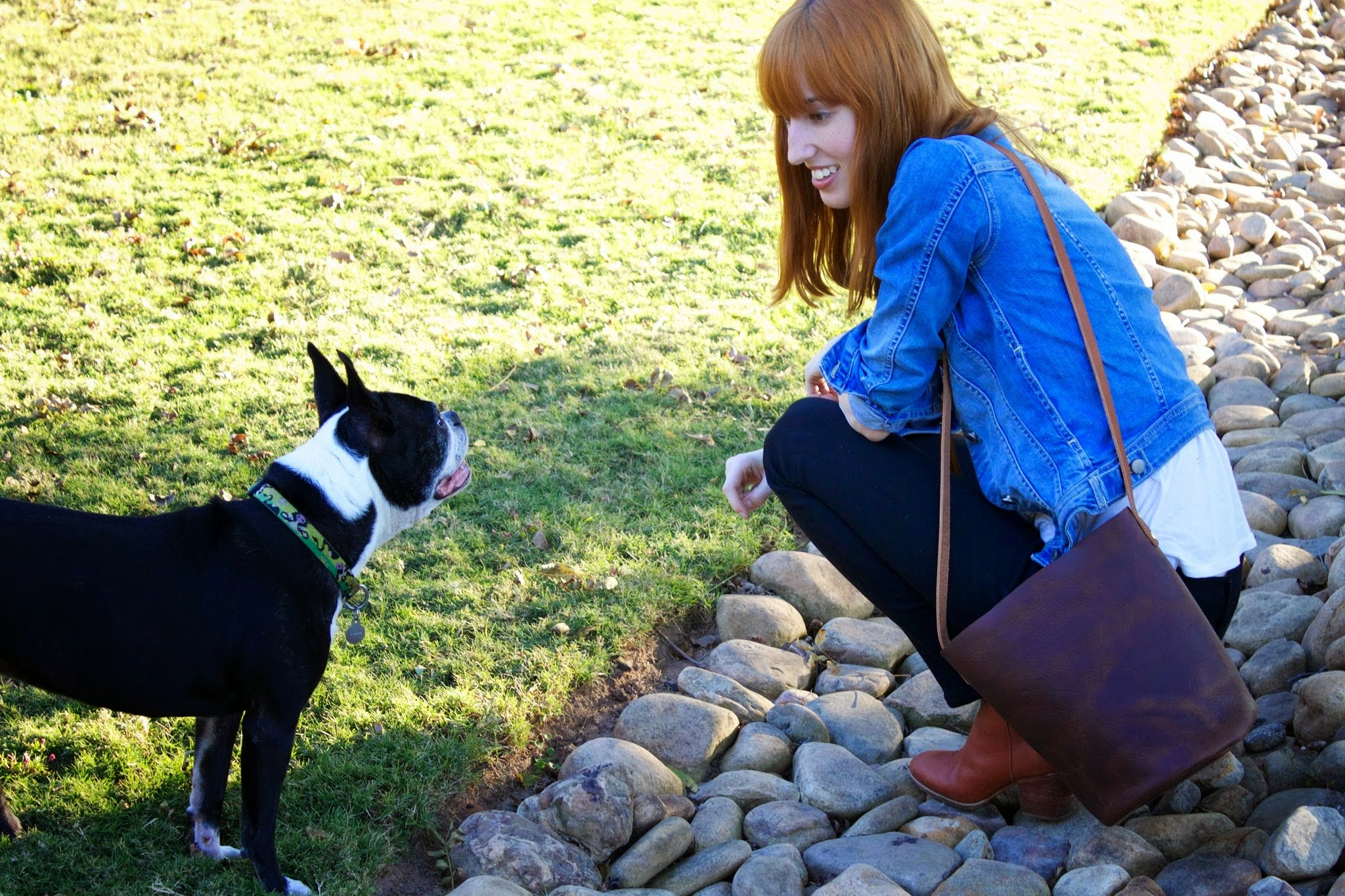 Neva Opet Owner and Maker Rachel Riedinger with her Handcrafted Leather Purse and Dog