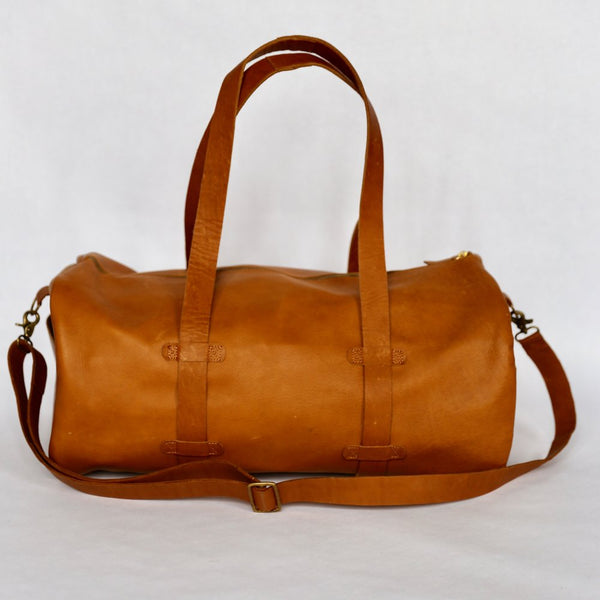 Meyelo Fair Trade Leather Duffle Bag ~ Pre-Order! - accessories, accessory, african, assorted-styles, bag, bags, bags-clutches-wallets, bags-purses, Bohemian, boho, brass, brass detail, Brown, Canvas, chic, clean-water, cruelty free, day, days, duffle, Eco, eco-friendly, education, ethically sourced, fair, fair-trade, father, fathers, for her, for him, gift, gifts, gifts-for-him, green, handmade, inside zippered pocket, Kenya, leather, leather accessories, leather duffle bag, leather gifts, locally sourced