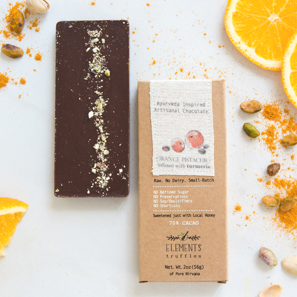 Orange Pistachio Chocolate Bar with Turmeric Infusion by Elements Truffles - ayurveda, chocolate, chocolate bar, chocolate bars, chocolates, dairy free, dairy free chocolate, dark chocolate, Eco, edibles, education, elements truffles, ethically sourced, fair-trade, gifts-for-the-host, gifts-for-the-occasion, Hand Crafted, hand made, orange, orange chocolate, orange pistachio chocolate, orange pistachio turmeric, orange pistachio turmeric chocolate, organic, organic chocolate