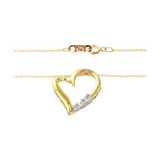 10k Gold and Diamond Three-Stone Heart Pendant Necklace