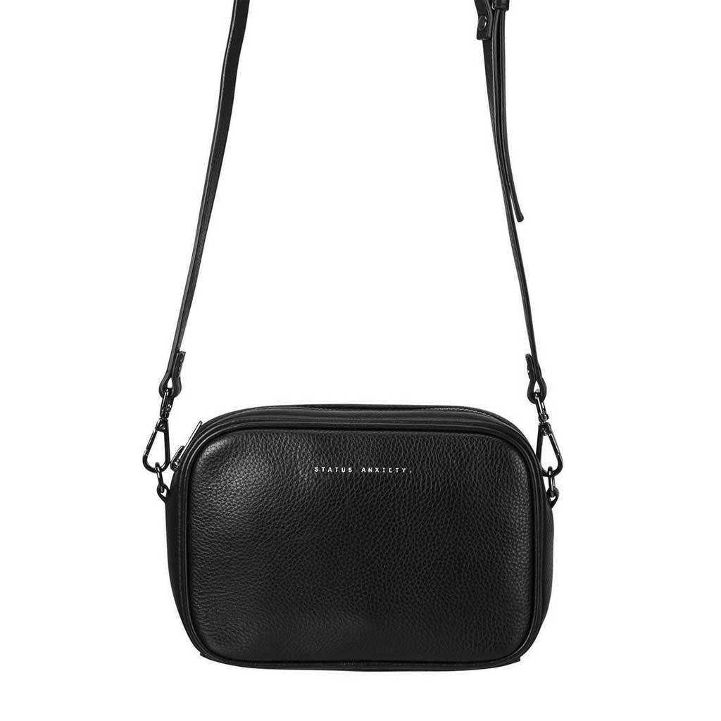 Status Anxiety cross body handbag black hanging close