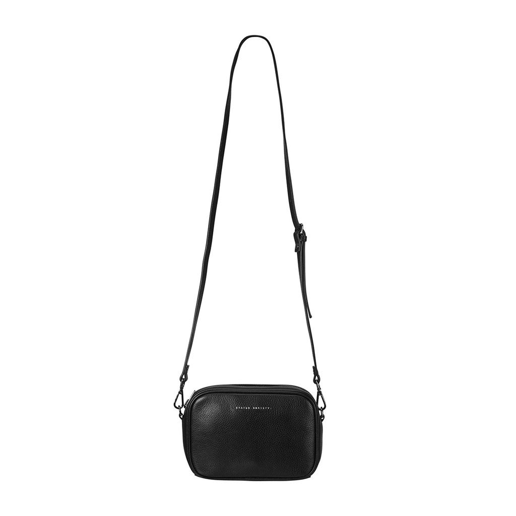 Status Anxiety cross body handbag black hanging