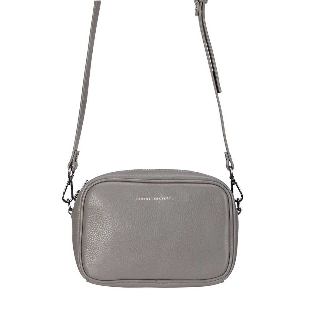 Status Anxiety cross body handbag cement grey front hanging clos