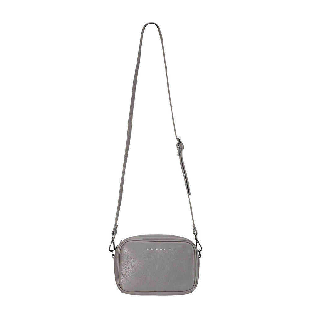 Status Anxiety cross body handbag cement grey hanging