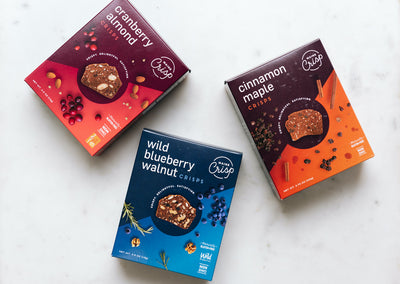 three boxes of Maine made gluten-free crackers, cranberry almond, wild blueberry walnut, and cinnamon maple