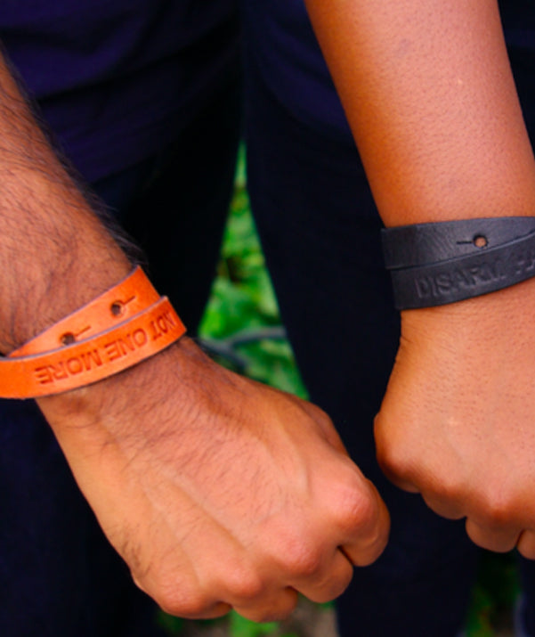 "Donate and get your ""Disarm Hate"" Leather Bracelet"