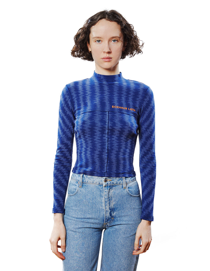 LAPPED BABY TURTLENECK IN STATIC