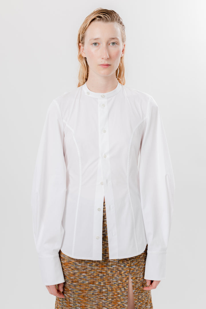 female model in white open back button down dress shirt