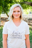 love never fails vneck
