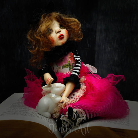 Alice in wonderland tumbles once again down the rabbit hole on this beautiful handmade art doll created by the talented hands of Danita Art