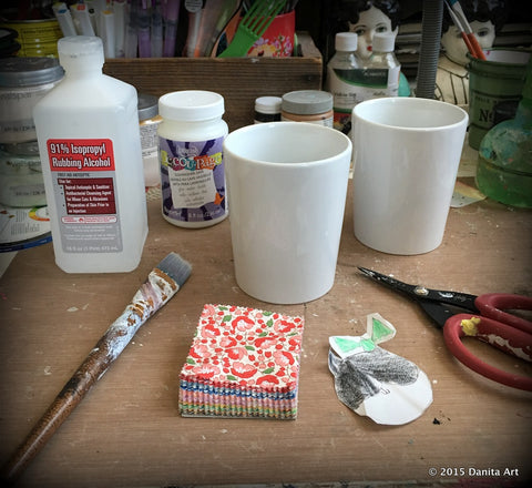 Danita is preparing the materials to create a DIY art mug with her daugter's cat drawing and some DecoArt Dishwasher-Safe Decou-Page™