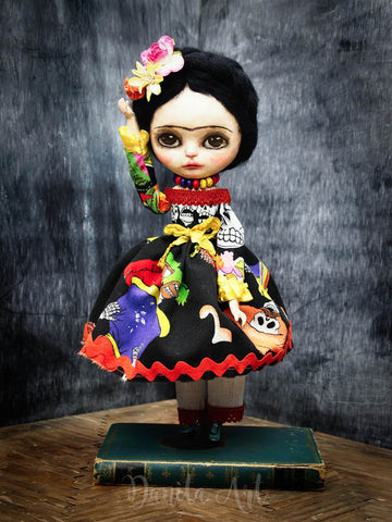 Frida Kahlo comes to life on this interpretation of a powerful icon by Danita Art, An Art Doll created with Paper Clay, Fabric and hand poured ceramics.