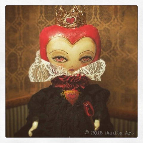 A detail of a beautiful Worderland Red Queen Doll created by Danita Art