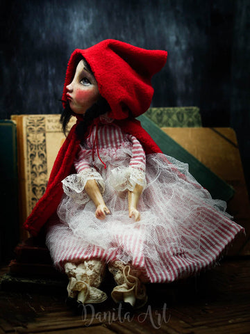 Little Red riding hood is a handmade art doll created by the fantastic and talented hands of Danita
