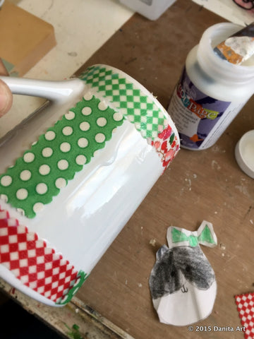 Danita's daugther created an adorable tuxedo cat that will be preservedon this super easy DIY tutorial for a coffee mug.
