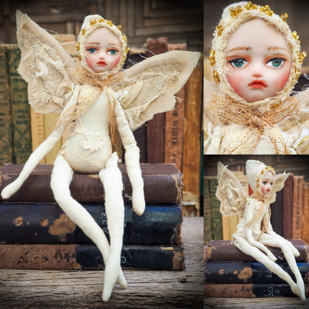 Hand Made art doll by Danita Art. Angel in white with detailed polymer claim face. Hand sewn clothes make each doll a unique Danita artwork.