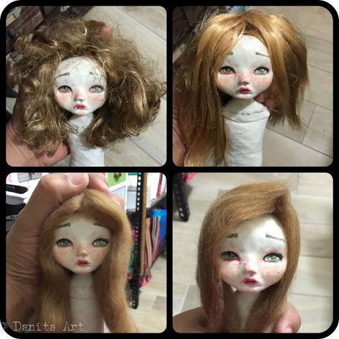 This art doll had to get many hairstyles tested until Danita was satisfied with how she looked before finishing sculpting her face.